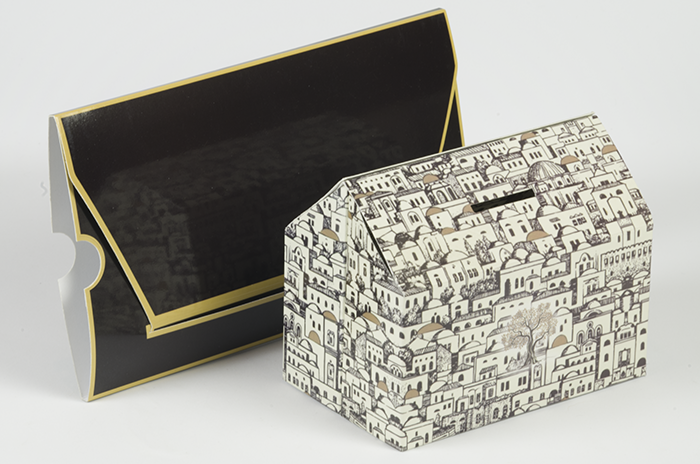 cardboard money box in the shape of a house